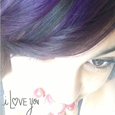 a girl with purple highlights