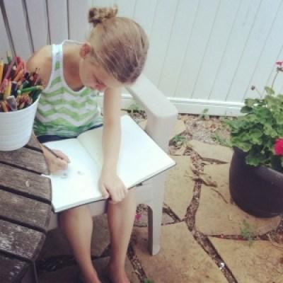 child doing art outside