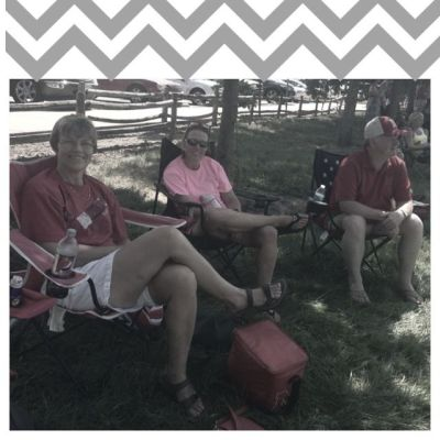family sitting at soccer game