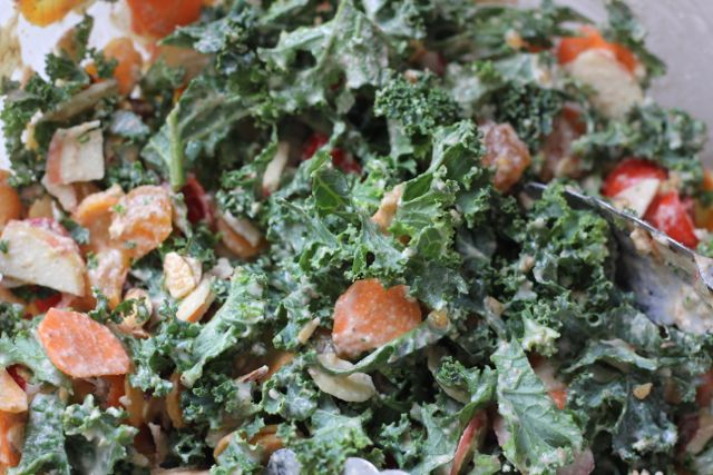 kale salad tossed with dressing