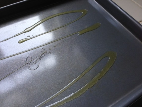 Olive oil drizzed on baking sheet