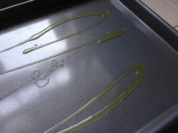 Olive oil drizzed on baking sheet