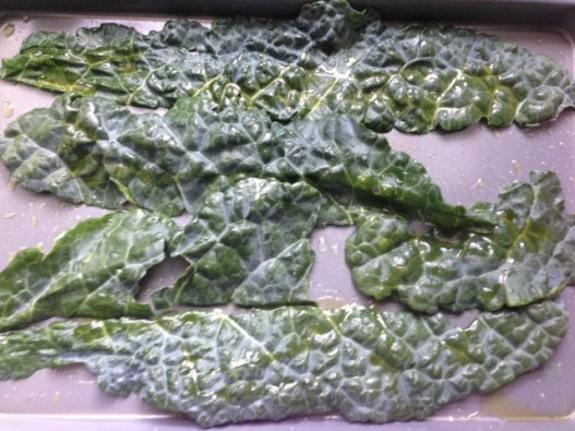 Tearing kale into pieces.