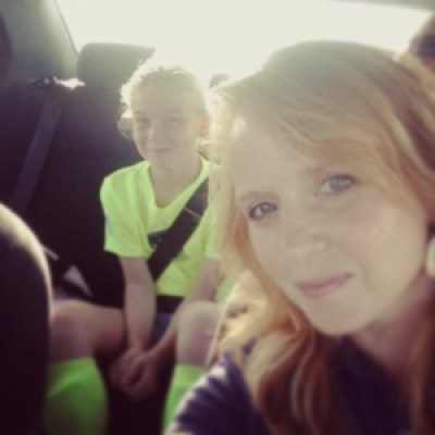 mom and soccer daughter in car
