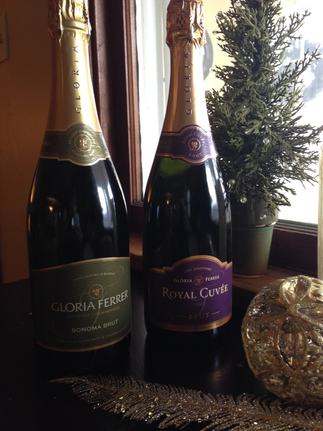 2 bottles of Gloria Ferrer Wine & a sparkly gold ornament