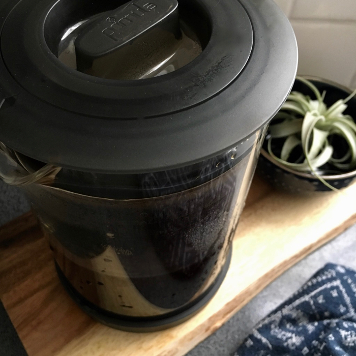 cold brew coffee pitcher, towel and succulent