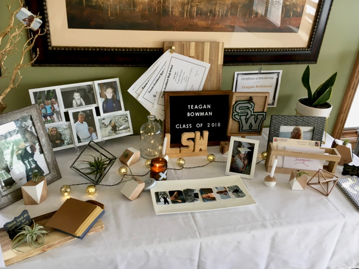 table with items to celebrate a graduation open house