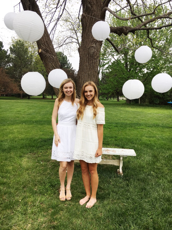 white globes hanging from a tree for photobooth backdrop