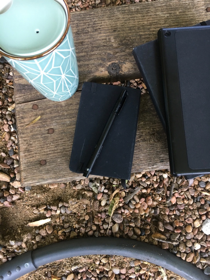 journal and coffee cup