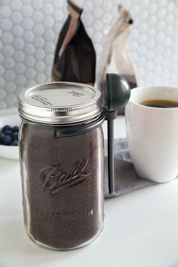 mason jar of coffee with a coffee scoop