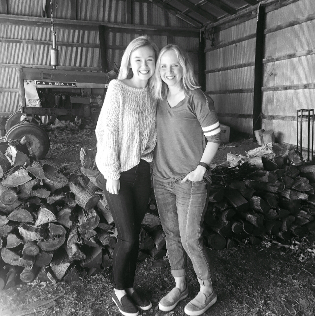 mother and daughter in a barn