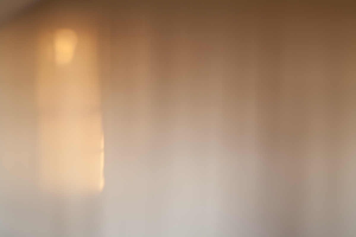 Photographic image of light shining on a wall.