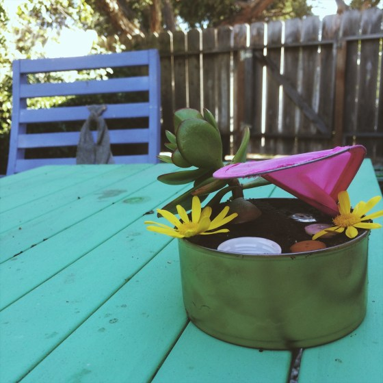 mini garden for fairies made of recycled odds and ends, click through to see how my daughters and I made tin can fairy gardens