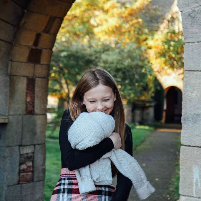 Girl in church archway looking sweet