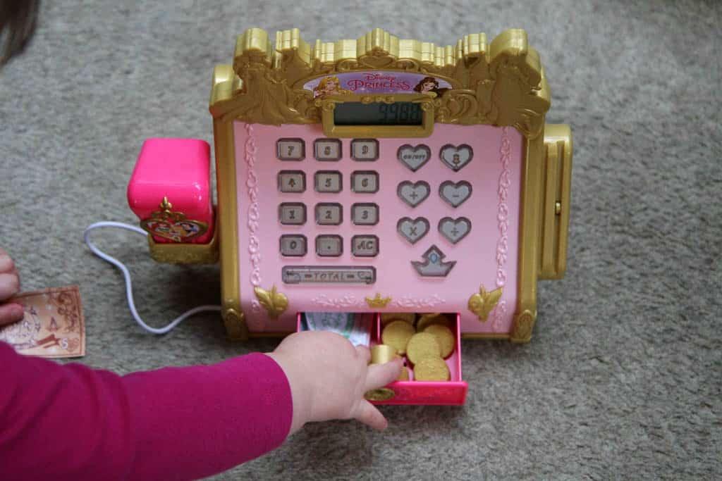 Opening cash drawer of Disney boutique cash register