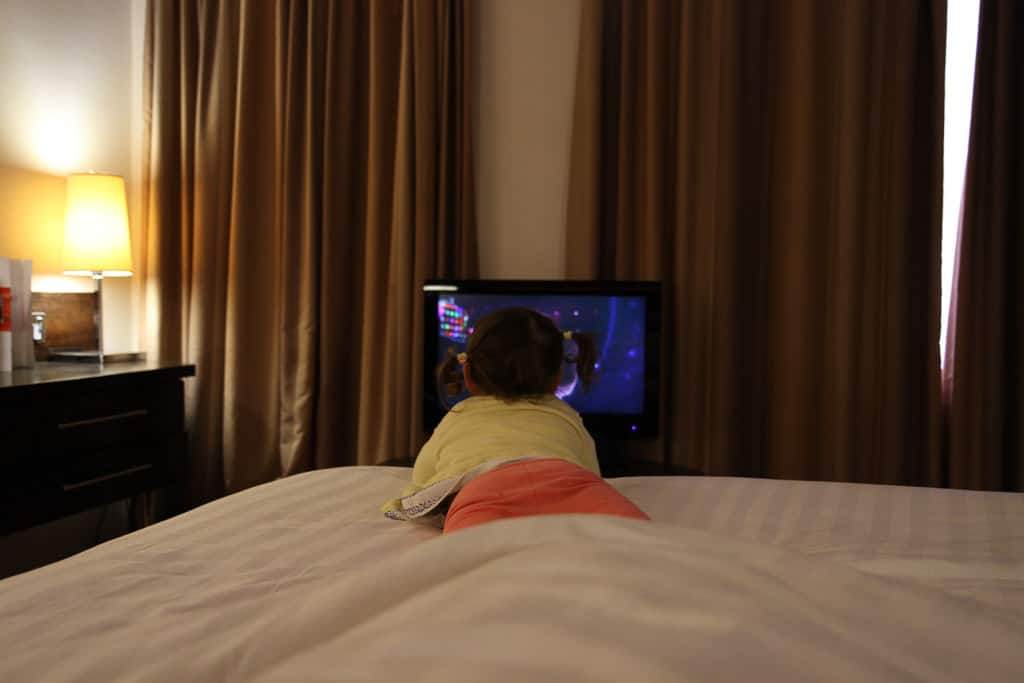 Watching TV in the junior suite at The Dragon Hotel