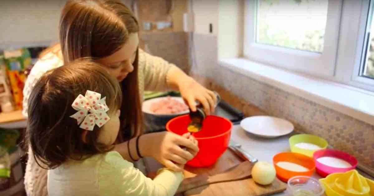 Holly and Rose cooking a delicious meal from scratch with using chicken korma spice blend from Schwartz