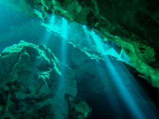 Light streaming in from an opening in the caverns.