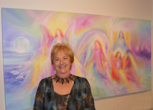 Glenyss Bourne    with one of her Angel Paintings.CO Creation