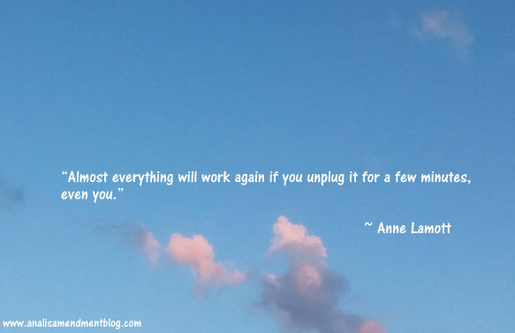 Photo of blue sky with clouds and text of quote by Anne Lamott about needing to unplug.