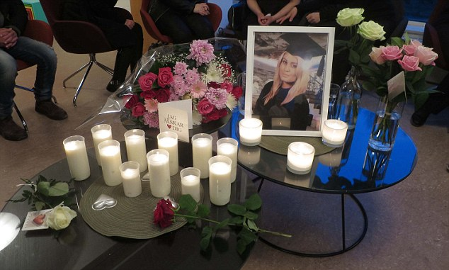 Alexandra Mezher, 22, a Swedish social worker who was allegedly stabbed to death by a 15-year-old asylum seeker at a shelter for refugee children. Gothenburg, Sweden. Candles and floral tributes and photo of Alexandra Mezher at a memorial service for the murdered girl in her home town of Boras today.