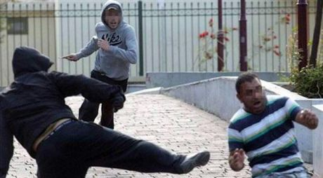 Two neonazis chasing a migrant