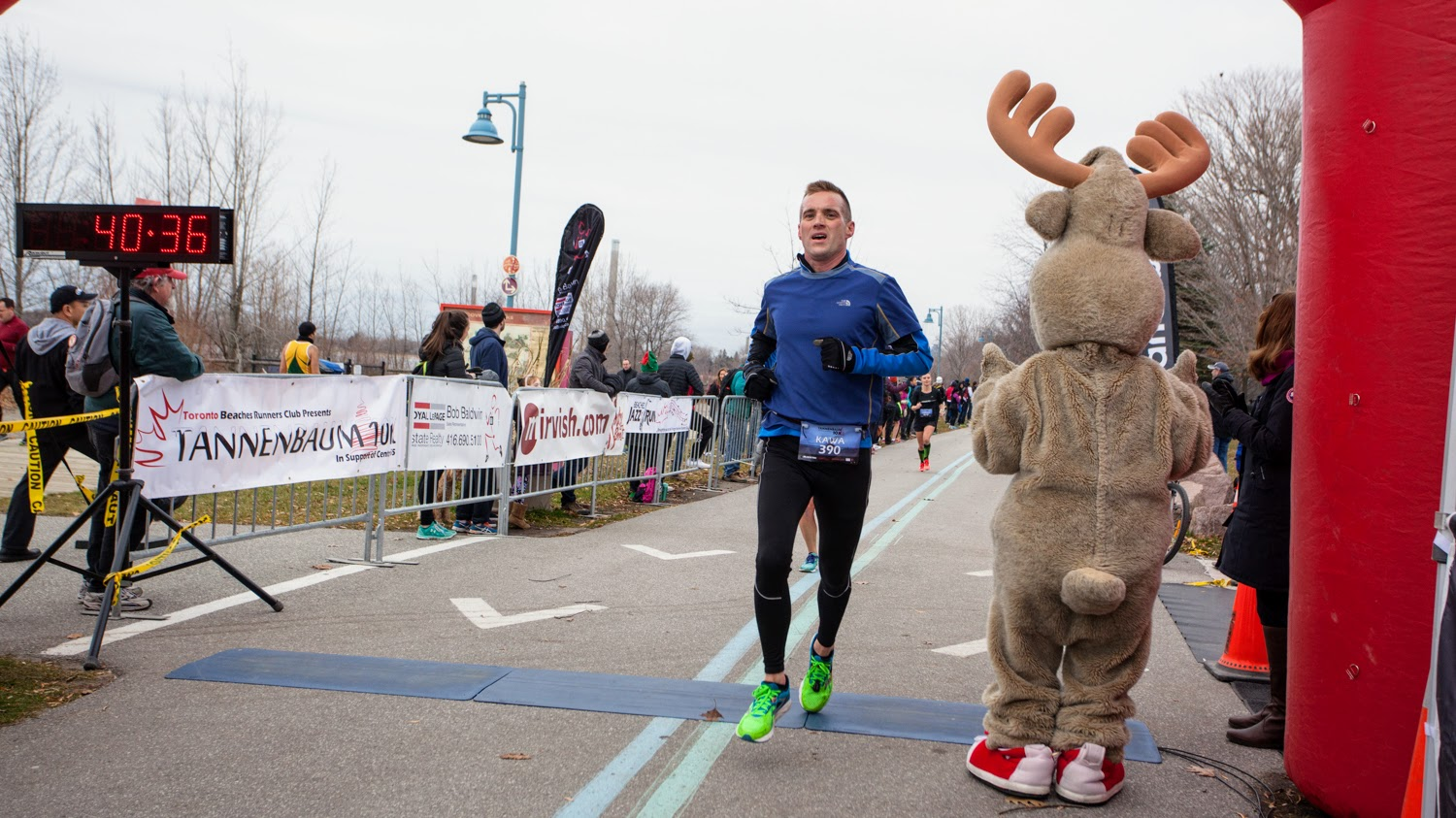Crossing the finish line at the 2016 Tannenbaum 10k at the 40:36 mark, setting my 10k PB at 40:29