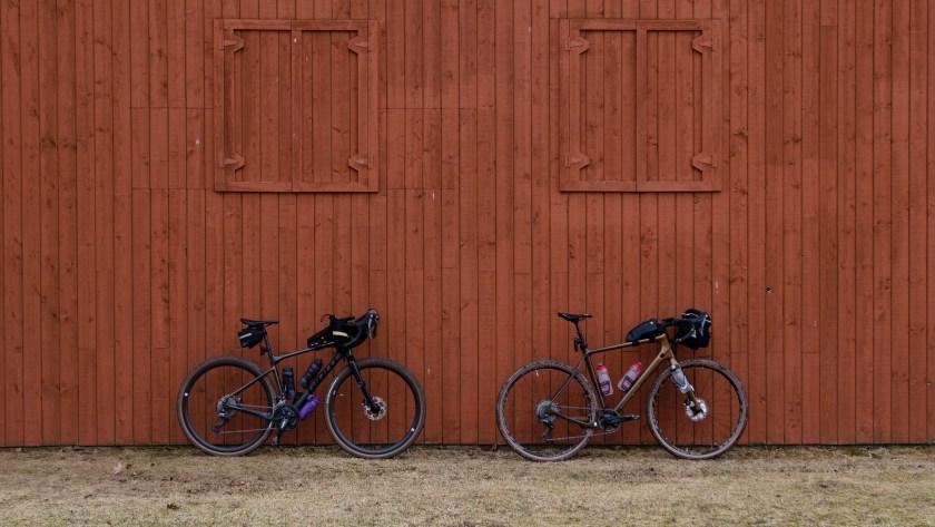 Photo of our gravel bikes against an brownish orange barn in Elgin Park Uxbridge.