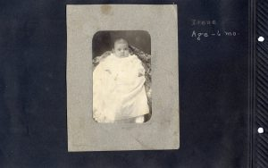 Photo album page of six month old baby in 1902.
