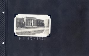 Photo album page of a photo of the Hughson Union High School in 1921