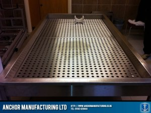 Stainless steel morgue table.