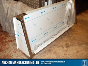 Steel urinal trough with welded seams.