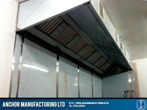 Kitchen canopy hood with steel wall cladding.