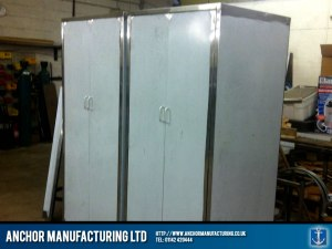 Deep storage kitchen cupboards in stainless steel .
