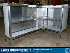 Steel breakfast bar storage area.