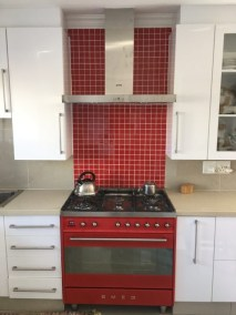 Anchor Property Group - kitchen renovation red tile wall cubboards