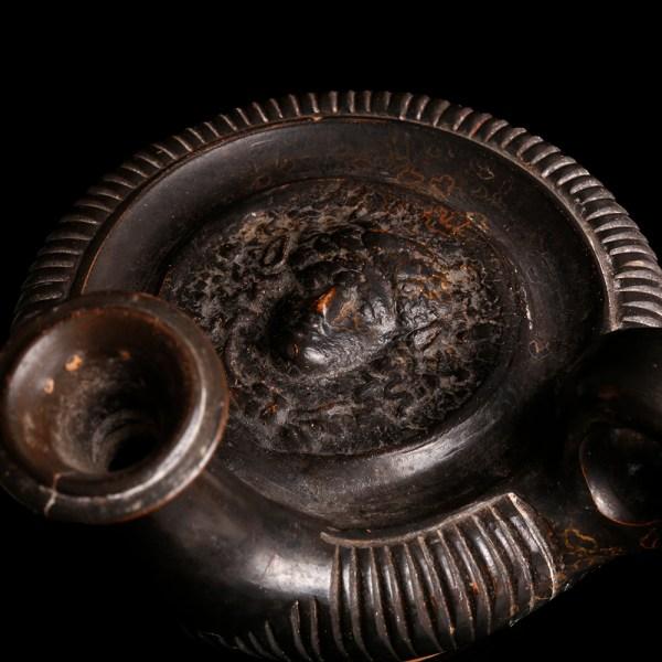 Apulian Blackware Guttos with Medusa