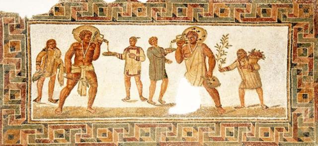 Suelo de mosaico hallado en Dougga (siglo III d. C.) con esclavos sirviendo vino en un banquete. (CC BY-SA 2.0)