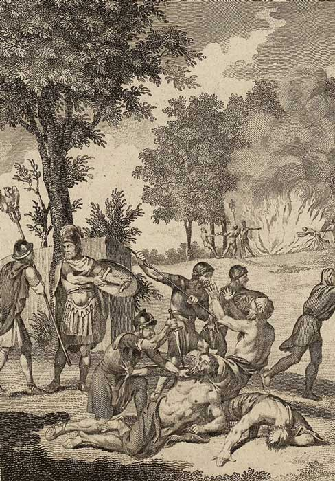 Soldados romanos asesinan druidas y queman sus arboledas sagradas en Anglesey, como narra Tácito en sus Anales. (Public Domain)
