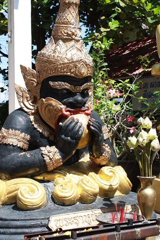 A statue depicting Rahu swallowing the sun, thought to cause eclipses in Hindu beliefs. Thailand.