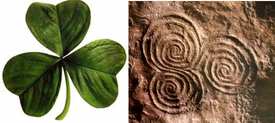 An Irish shamrock on the left, and the triple spiral symbol on the right.