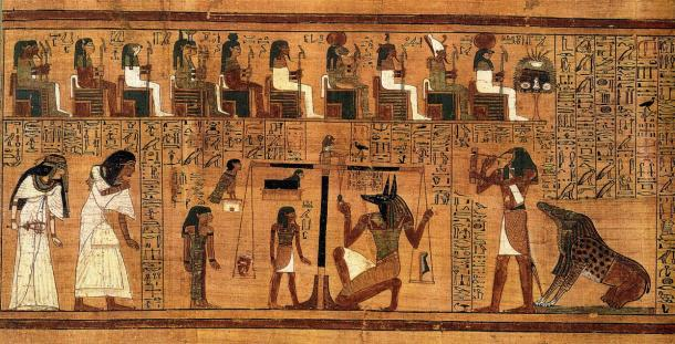 """Excerpt from the 'Book of the Dead', written on papyrus and showing the """"Weighing of the Heart"""" using the feather of Maat as the measure for the counter-balance."""