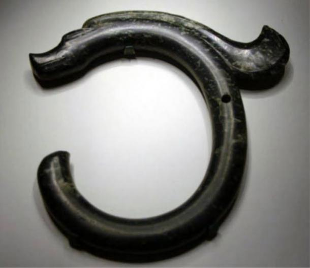 The C-shaped jade dragon of Hongshan Culture.