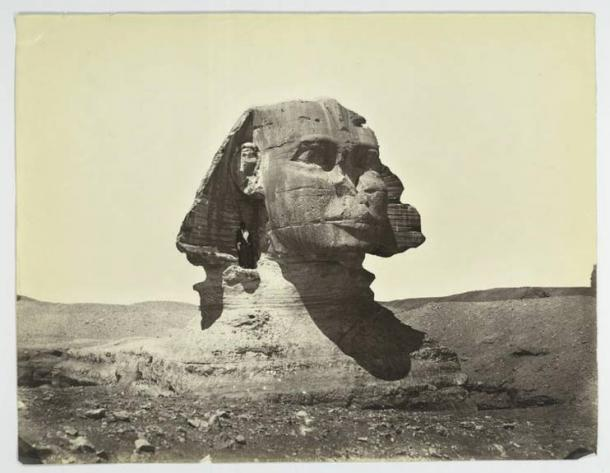 The Great Sphinx in 1867. Note its unrestored condition, still partially buried body, and man standing beneath its ear.