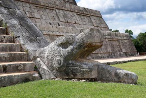 Serpent head at the base of El Castillo