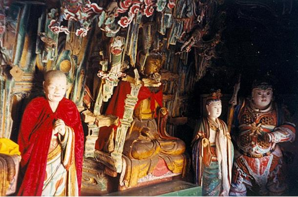 Statues inside the hanging monastery reflect different religious traditions