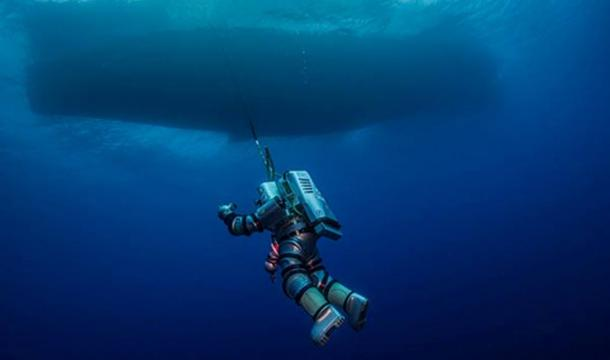 """WHOI Diving Safety Officer Edward O'Brien """"spacewalks"""" in the Exosuit, suspended from the Hellenic Navy vessel THETIS during the 2014 Return to Antikythera project."""