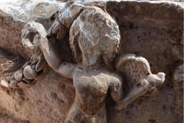 One of the cupids on the limestone sarcophagus, Ashkelon, Israel