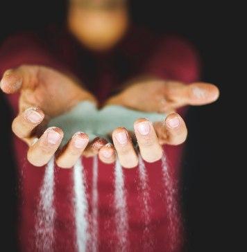 Sand slipping through hands