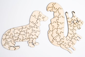 Custom wooden laser-cut squirrel and daschund puzzles